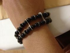 Bike parts bracelet (chain plates and rollers with beads). --Designed and fabricated by Esther Cervantes