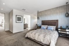 This velour bed head adds a touch of luxury to this bedroom and really complements the feature wall and patterned linen! | Sekisui House