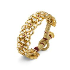 Every Devam design is unique in its design and creation. These beautifully crafted bangles bring together Polki Diamonds, Rubies, and yellow gold for an elegant and inspiring masterpiece. Royal Jewelry, Indian Jewelry, Fine Jewelry, Gold Jewellery, Vintage Jewelry, Diamond Jewelry, Diamond Bangle, Jewelry Stand, Bridal Jewellery