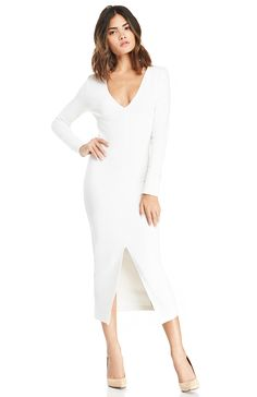 Your sexy curves will be put on display when wearing our Long Sleeve Bodycon Dress. This dazzling garment features a V neckline, long sleeves, front slit hem, and a midi length. Perfect your curves with our Seamless Nylon Slip. Spotlight will be on your dress, so keep your accessories light with a silver ring and black high heels.
