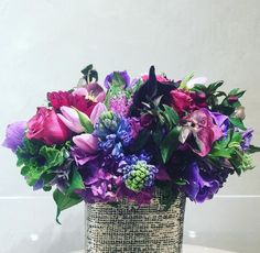 Fuchsia and purple centerpiece by Nisie Enchanted