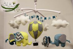 With MUSICAL CRIB ATTACHMENT. Teal blue, yellow and grey, hot air balloon and elephants babies musical rotating mobile. Ready to ship