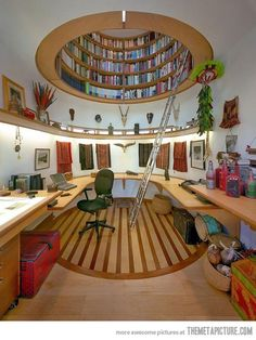 fabulous home office / library ... the final touch would be a stained glass dome with natural light at the top of the library..... :)