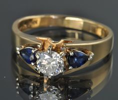 1.10 Carat Diamond and Sapphire Ring, $1495.00