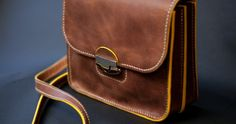 Horween faun colored double gusset purse with yellow edges