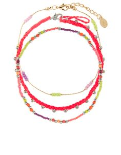 Accessorize £8 Bring on the brights with our Fiji three-piece anklet set, featuring neon bead and cord designs.