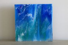 This unique trio of paintings was created using epoxy resin to give a glossy, glass like finish that enhances the colors and provides a 3 dimensional effect. This trio of colorful paintings would make a vibrant additional in any space.  Colors - blue, green, white Dimensions - 10 inch by 10 inch Depth - 2 inches thick Material - Wooden panel, epoxy resin, acrylic, ink Side - finished with blue paint  Signed on front of the painting.  *** Id be happy to make something similar or a pair or…
