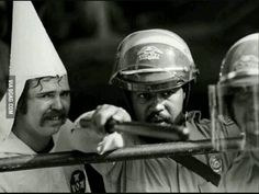 "Can you say Ironic? A black policeman protects a KKK member, as protesters were closing in on them at a rally in Austin, Texas Wow. ""Ironic"" is a word, but I feel ""heroic"" is more fitting. Rare Historical Photos, Rare Photos, Iconic Photos, History Books, World History, History Photos, Black Art, Photos Rares, Non Plus Ultra"