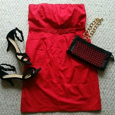 """Lovely strapless red dress Beautiful red strapless dress with belt. Dress has pockets, back zip, and back slit. Lovely dress, just too small on me right now. Measures 30.5"""" inches from top to bottom. Size 10 but could also fit an 8.  Great condition! limited Dresses"""