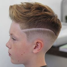 Low Bald Fade with Design and Brushed Up Hair