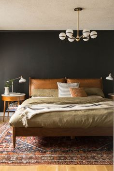 Tricorn Black Master Bedroom Reveal featuring mid-century furniture, family gallery wall, crown molding, etc! #midcenturybedroom #westelmbed