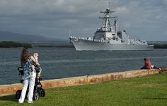 Family members of Sailors aboard the guided-missile destroyer USS Chung-Hoon (DDG 93) observe the ship's departure from Joint Base Pearl Harbor-Hickam for an independent deployment to the Indo-Asia-Pacific region. The ship and its crew are scheduled to conduct integrated operations in conjunction with allies and partners. (U.S. Navy photo by Mass Communication Specialist 3rd Class Diana Quinlan/Released)