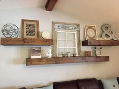 Living Room decor - rustic farmhouse style floating shelves over sofa in natural wood.