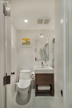 Simple and clean white bathroom with wood accents in Williamsburg.