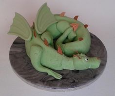 """'I made this for my nephew's birthday. I started with a ring shaped cake and carved the general shape for the body."""" Cake by Mumsnet poster Wem Viking Party, Medieval Party, Cool Cake Designs, Cool Shapes, Dragon Party, Dragon Egg, Amazing Cakes, Cake Ideas, New Books"""
