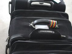 c92fcac5f1 Do you own a black rolling suitcase  So does everyone else. Here s how to