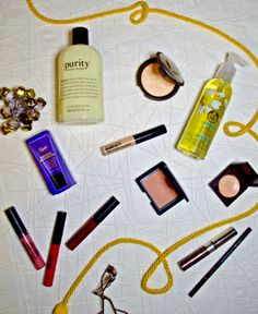 2015 Beauty Favorites: Purity facial wash, Kiehl's Midnight Recovery Eye, Nars Madly blush, Anastasia Beverly Hills Brow Wiz & Brow Gel, Ofra Cosmetics Liquid Lipsticks, Champagne Pop, BareSkin Serum Concealer, & The Body Shop Camomile Cleansing Oil