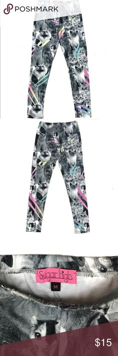 "Sugar High Cat Leggings An awesome pair of kitty leggings featuring cats of all kinds in black and white and colorful lasers shooting out of their eyes.  Size medium.   Waist measures 22"" without being stretched but stretches as wide as 29"" / inseam is 26.5"" / 97% polyester / 3% spandex.    Not a member of Poshmark yet?  Use coupon code TENSQUARED for a $5 discount off your first order! Sugar High Pants Leggings"
