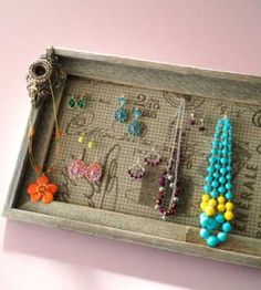 DIY Jewelry Frame:  Make your own DIY Jewelry Frame to display earrings, necklaces and bracelets in style.  countrywomanmagazine.com