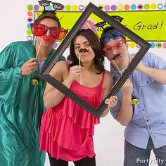 A frame and silly 'staches-on-sticks are must-haves at a grad party photo booth station.LOVE THIS Perfect for a memory book!!!!