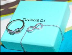 IN LOVE!!! Tiffany's infinity necklace & ring! Sent a pic of this to my BFs phone, hoping to give him an idea of what I want for my birthday!!!! :)