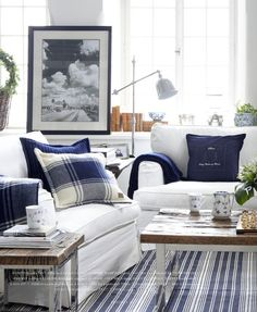 a perfect room for summer...blue striped rug, plaid pillows, white slipcovers