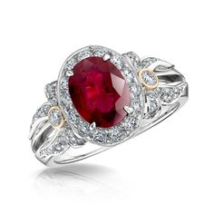 Alix Ruby Halo Ring - oval ruby and round white diamonds set in 18 carat white and rose gold