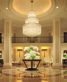 Grand lobby / ceiling detail / feature lighting / sharp metal work / panelled columns
