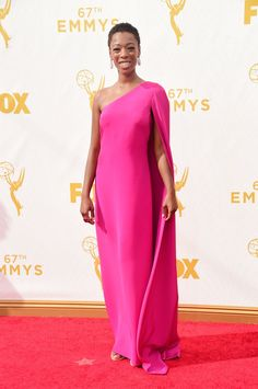 Pin for Later: The OITNB Stars Didn't Wear a Drop of Orange on the Emmys Red Carpet Samira Wiley Samira Wiley made an elegant choice with her hot-pink one-shouldered cape dress.