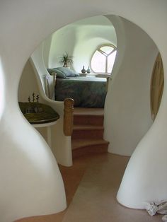 curved walls... i like the idea of curves leading the eye deeper into the house, but I can't imagine living with it.