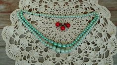 Check out this item in my Etsy shop https://www.etsy.com/listing/517178324/retro-aqua-blue-beaded-necklace-blue