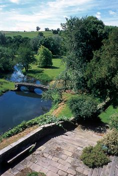 Haddon Hall garden - looking down from the Fountain Terrace onto Dorothy Vernon's Bridge, a 16th Century pack horse bridge over the river Wye.