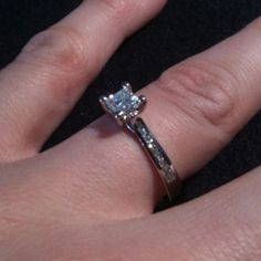 Just finished by Diamonds and Rings.  Palladium princess cut diamond engagement ring with round brilliant cut diamond shoulders.  IGI certification.  Sku: pc139-dss @ www.diamondsandrings.co.uk