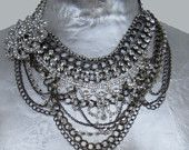 Rhinestone and chain DIY statement necklace. Several necklaces put together and then a brooch and several chains have been added.