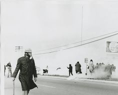 """Alabama state troopers wear gas masks as tear gas is fired on marchers in 1965. Fifty years ago, about 600 people began a 50-mile march from Selma, Alabama, to the state capital of Montgomery so that they could protest discriminatory practices that prevented black people from voting. But as the marchers descended to the foot of the Edward Pettus Bridge, state troopers used brutal force and tear gas to push them back. The event is now known as """"Bloody Sunday."""" Revelation 17, Babylon The Great, The Trooper, Civil Rights Movement, Interesting History, African American History, Black People, First World, Black History"""