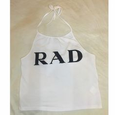 """RARE Brandy Melville halter top Rare John Galt """"RAD"""" white sachi halter top. Velvet letters. This item is new without tags. Hard to find piece. Firm on price. Brandy Melville Tops Tank Tops"""