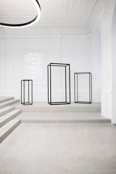 Svet Vmes adds black-framed glass cabinets to school entrance hall.