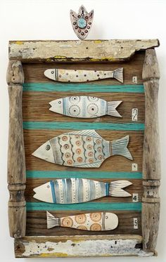 Awesome mixed media ideas from this artist Shirley Vauvelle mixed media ,ceramic fish art with sea beach theme click now for info. Clay Projects, Clay Crafts, Arts And Crafts, Ceramic Pottery, Ceramic Art, Clay Fish, Wooden Fish, Driftwood Crafts, Coastal Art