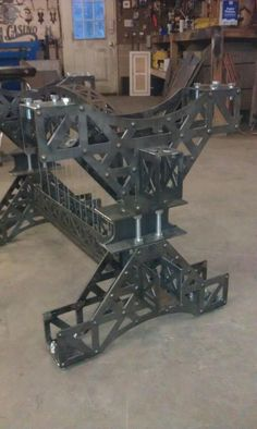 Custom designed and made wrought iron tied truss bridge table base with cables. Gets glass top. Made by Village craft iron