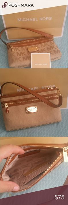 Michael kors wristlet I have two of these one tan one black . Both are new with tags Michael Kors Bags Clutches & Wristlets