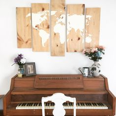 Easy wood world map wall art DIY  Step 1: buy different sized boards at home improvement store  Step 2: wood stain  Step 3: search for a free printable map online  Step 4: trace  Step 5: paint  Step 6: glossy stain  Step 7: add cheap hardware and hang  Total cost: $20!