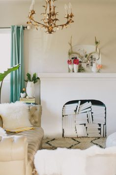 The white books were left over from a wedding I designed years ago.  The gold chandelier hung in my childhood home since the 1920s and my mo...