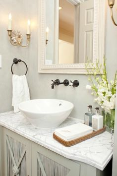 Munger Interiors - bathrooms - blue, gray, walls, gray, bathroom cabinet, round, vessel, sink, oil-rubbed bronze, wall-mount, faucet, towel ring, brass, sconces, ivory, mirror, calcutta gold, marble, counter top,