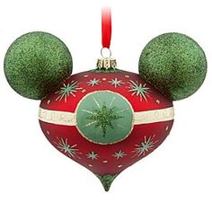 Disney Mickey Mouse Retro Ornament | Disney StoreMickey Mouse Retro Ornament - Fashioned in the iconic likeness of Mickey, complete with glittering green ears, this elegant glass ornament features a retro design that will make it a timeless holiday favorite every year!