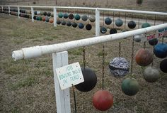 Bowling Ball Art Fence...that would be a heavy fence. Would not want to be near when there's a strong winds.