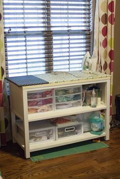 homemade ironing station and scrap storage  in a little bookcase with great proportions