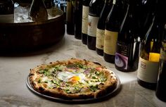 The best meal? Pizza and wine. Asparagus Pizza with Farm Egg made in the wood-fired oven at Redd Wood Restaurant in Yountville.