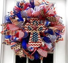 A personal favorite from my Etsy shop https://www.etsy.com/listing/233393524/fourth-of-july-deco-mesh-wreath-4th-of