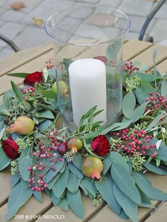 Wreath and Candle Centerpiece @ Sonoma Wedding.  Seeded eucalyptus, pepper berry, red spray roses and pomegranates.Sonoma County wedding flowers by The Wild Orchid. wildorchid707.com