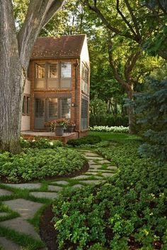Nice garden but the two story sunrooms ...love them!  Great idea for the back of our house.  One off the lower level family room and the upper off the master bedroom.  garden by e-liza